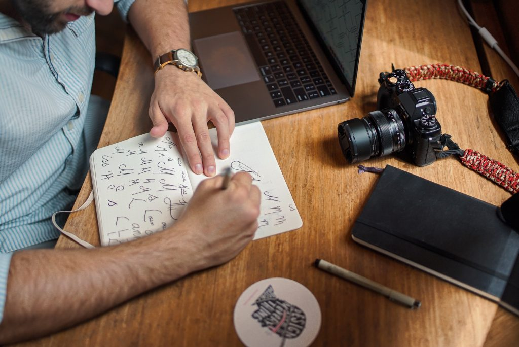 A man designs logos and fonts for web marketing efforts.