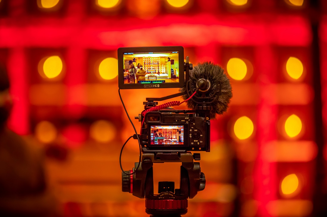 Video camera and boom setup on a red stage