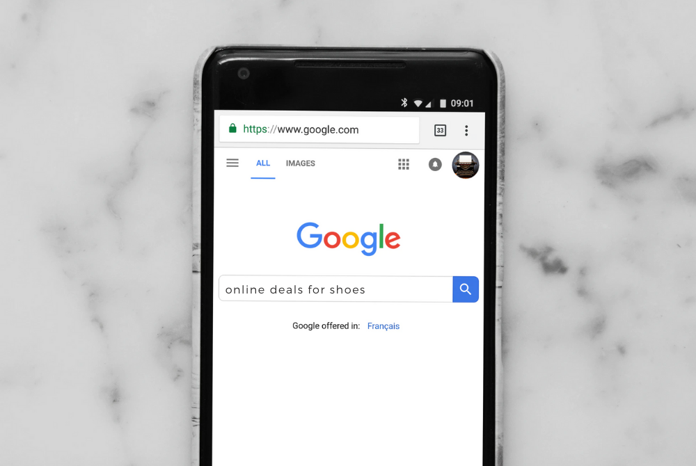 smart phone on google searching for online deals for shoes