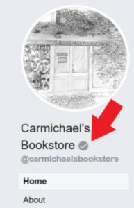 Facebook grey check mark on business page