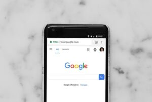 Smartphone open to Google's mobile homepage.