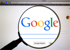 Magnifying glass over Google Search.