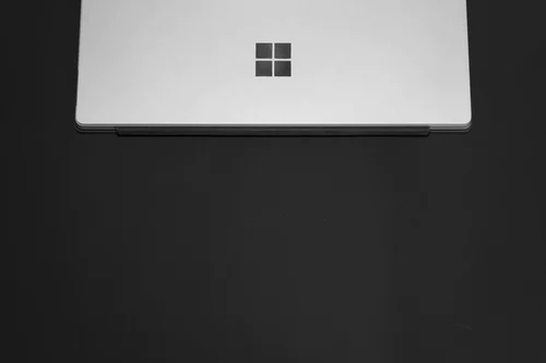 Closed gray laptop with microsoft logo