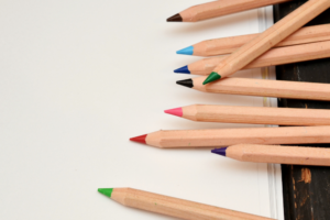 Group of coloured pencils on a sheet of paper