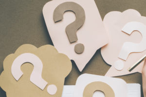 Brown, beige, and white question marks