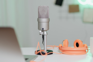 Microphone with pink headphones