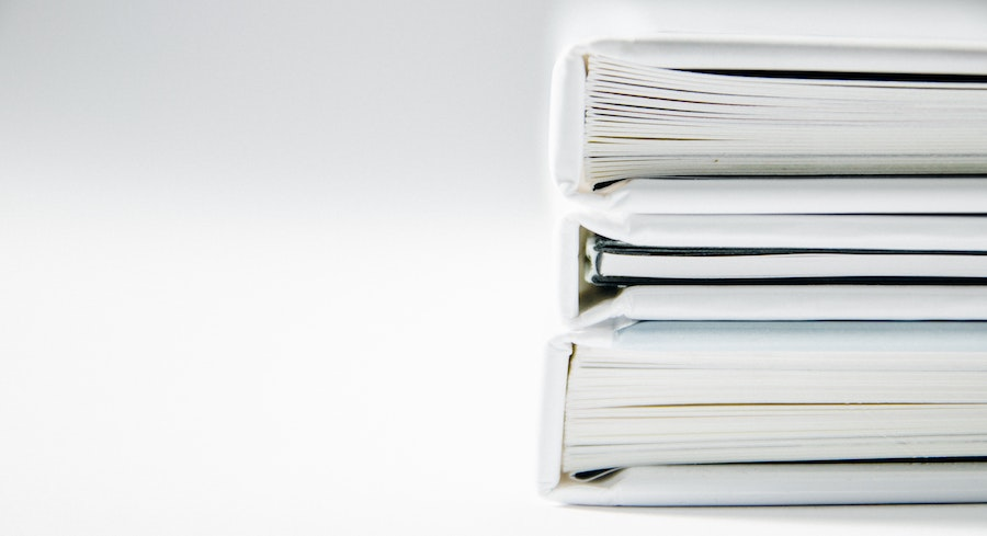 Stack of white binders