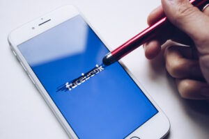 Pen crossing out Facebook on phone app